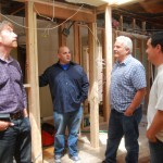 Beau talking to investor and 2 contractors.